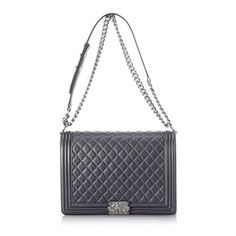 The lines are classic, but the look is unmistakably modern. Chanel's stunning Boy Flap Shoulder bag features a quilted charcoal grey leather exterior, finished with antiqued silver-tone hardware. A logo-embossed push-lock opens the front flap, while four leather-and-chain handles provide a chic finish.