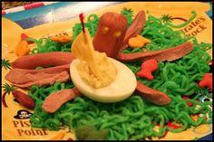 deviled egg sail boat, hotdog octopus (Cracken), and spaghetti sea weed.