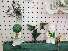 Rescued from a chippy shutter! this sweet notched flower holder! She'll hold over a dozen stems! Shown w/ a few of our Spring candles, our rustic metal beaded butterflies, & our seed packet pillow! Keeping it fresh for Spring! Our 5th year at Craftiques Mall ~ <3 ~ We are Treasured Gifts, In the Window, & Let Nature Sing Gifts; Michelle White Shopkeeper Visit our shoppes on their facebook pages 3/1/16 ~ <3 ~ !