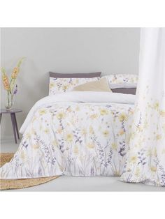 Ida Waterolour Floral Duvet Set in Double and King Sizes The perfect pick-me-up for dull bedrooms, this Ida duvet cover set is decorated in a sunny print of water-coloured florals winding their way up a plain white base. Made from a soft and comfy polycotton fabric, a set includes 1 duvet cover plus 2 pillowcases.Complete the look with matching pleated curtains, which are available separately (see item number KXGHJ).Material Content: Easy Care 50% Cotton, 50% PolyesterWashing Instructions…