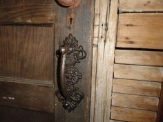 There are two holes for mounting. Although it is pretty sturdy, Cast Iron does not bend under stress like a steel door construction would. There is a beautiful scroll design with a Lion Head in the center. Door Pulls, Knobs And Pulls, Door Knobs, Door Handles Vintage, Scroll Design, Iron Doors, Steel Doors, My Dream Home, Dream Homes