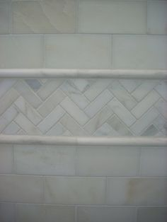 Master Bath Accent herringbone with marble subway tiles. The pencil moldings are a great frame. When you change patterns a molding to separate them makes a statement. If tiles aren't the same height, the molding hides that and the look is finished. Bathroom Renos, Bathroom Renovations, Small Bathroom, Bathroom Ideas, Remodled Bathrooms, Condo Bathroom, Bathroom Fixtures, Bad Inspiration, Bathroom Inspiration