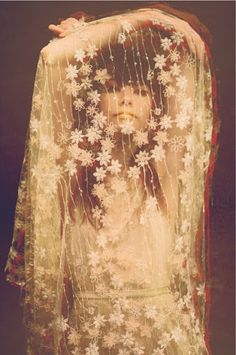 Lace veil with flowers... beautiful, vintage 60s - 70s perhaps? I'm going for 60s.