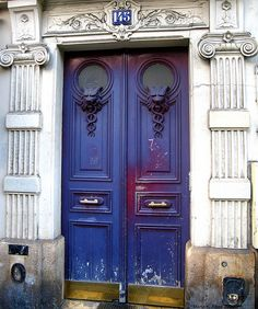 These vintage purple doors have a gothic feel to them.