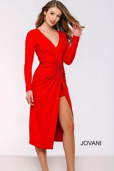 Red long sleeve dress features a high-low length, a deep v neckline, ruching at the midsection and a high thigh slit.
