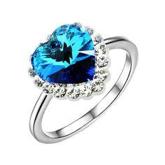Пленителен  дамски пръстен във форма на сърце от сини австрийски кристали с 18 карата бяло златно покритие. Тегло: 3.2 гр. Код: PS37.
