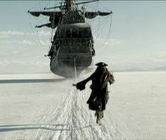 Jack Sparrow running after the Black Pearl