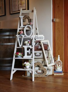 Wooden stepladders available to hire with suitcases, wooden love letters & vintage items. www.littleweddinghelper.co.uk Photography by @simonwithyman