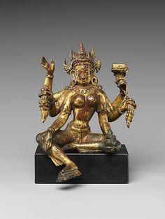 Vasudhara, Goddess of Wealth. Nepal, 14th–15th century. Gilt-copper alloy, h. cm. 13.5 cm. New York, The Metropolitan Museum.