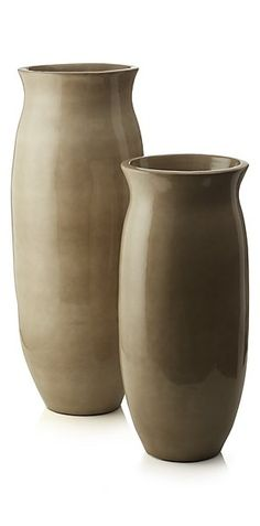 Our hand-thrown terracotta ceramic floor vase rises up tall, flaring to a  wide