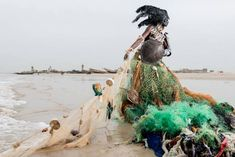 Gods Of Garbage In Pictures Art And Design The Guardian - Jun C B Fabrice Monteiro Travelled To The Most Polluted Places In Africa And Created Terrifying Characters Who Roamed Their Midst Dressed In Eerie Debris They Are Spirits He Says On A M Ocean Pollution, Plastic Pollution, Spiritual Figures, Art Environnemental, Trash Art, Colossal Art, Recycled Fashion, Photo Series, Environmental Art