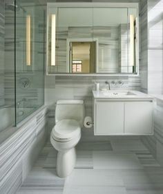 Stunning tile!! The white and light grey with the mirror really do make the space live larger.