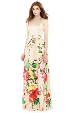 A simple bodice blooms into a full skirt full of bright and colorful flowers. Floral bridesmaid dresses like this one are suited for more formal events, and its floor-length hemline will probably require most of your friends to wear heels.
