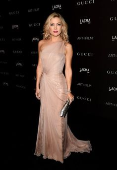 Kate Hudson in pale pink Gucci Premiere with silver accessories. November 2014