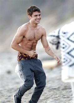 Shirtless Zac Efron. That is all. See more hot celebs on the beach on Wonderwall: http://on-msn.com/1nMpnPz