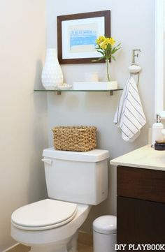 I like the hook for a hand towel. Over The Toilet Storage with Clear Glass Shelves.