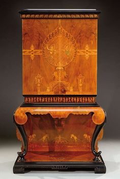 A collectors cabinet in black tinted wood with a rich exotic wood veneer - 1920.