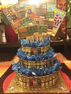 $200.00 Money Cake! (assembled, except the lottery tickets will need to be placed in top) Great for 16th, 18th(shown), OR 21st Birthdays and Graduations. Comes with $200 rolled cash. 16, 18, or 21- 1$ lottery tickets on top, glitter bottom 14 base, ribbon, tissue paper, and little occasion signs.