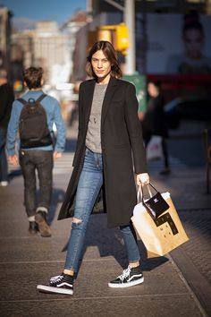Alexa Chung seen in the streets of Manhatttan wearing a cotton coat and sneakers on December 15 2015 in New York City