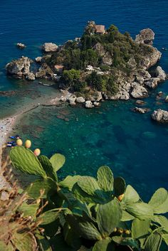 Taormina, Sicily, the most beautiful views with the best food and the best dressed people. it was the best of times -lol