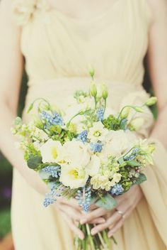 Delicate... like both the dress and bouquet.