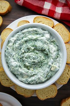 Creamy spinach dip made with Greek yogurt, lemon, fresh herbs, and feta cheese. Serve with warm pita, baguette, or chips.