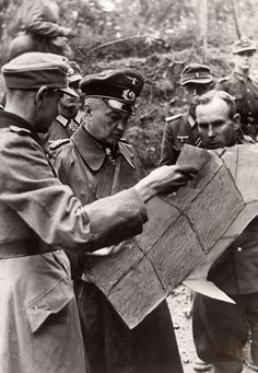 Walter Model are negotiating strategy based battle map presented by subordinates. Top right is Oberst Gerhard Wilck (Kommandeur 246. Volksgrenadier-Division/Kampfkommandant Aachen). The model is considered as the General with the best defensive tactics once owned by the German army, the Wehrmacht! Walter Model, Warsaw Uprising, Last Knights, The Third Reich, German Army, Military History, World War Two, Wwii, Germany