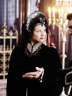 "KING HENRY PROMPTING QUEEN ANNE TO GO AHEAD WHEN THEY BOTH KNOW HE'S WANTING TO STAY BEHIND TO GET A GLANCE AT THE QUEEN'S ""LADY IN WAITING"", LADY JANE."