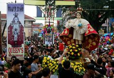 """Devotees gather around to touch the image of Saint Nino during the procession in Ati-Atihan Festival in Kalibo Aklan.The oldest of all Philippine festivals, Ati-Atihan """"make-believe Atis"""" honors the Saint Nino, and consists of tribal dancing, parades, with ethnic music all featuring indigenous costumes, and dates back to the 16th century.     AC Dimatatac Photography Orthodox Icons, Festival Party, Mardi Gras, Pinoy, 16th Century, Halloween, Holiday Decor, Festivals, Dates"""