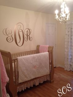 White & gold nursery. Love the sticker on the wall.