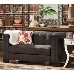 Brighten up the look of your living room with this elegant button-tufted loveseat. The-ultra comfortable piece features a deep seat, making it the perfect space to curl up with a book. The linen upholstery accents the simple color scheme.