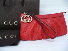 Gucci Interlocking G Charm Leather Clutch Red Wristlet. Get the trendiest Clutch of the season! The Gucci Interlocking G Charm Leather Clutch Red Wristlet is a top 10 member favorite on Tradesy. Save on yours before they are sold out!