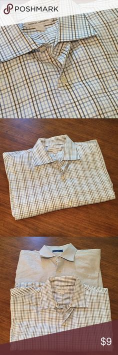 Banana Republic Men's Plaid Dress Shirt + Freebie Shirt is in excellent condition and freshly dry cleaned. White with blue and brown plaid, size XL 17-17 1/2. Buy this shirt and get a free Tom Jones dress shirt as well. Free shirt is pinstriped, is also in excellent condition, but does not have a size tag. Both fit similarly. Banana Republic Shirts Dress Shirts