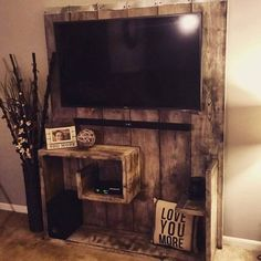 Country wall entertainment center with recycled pallets