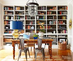 Wall-to-wall bookshelves and a sturdy farmhouse table help this versatile room pull double duty as both a home office and a formal dining room.