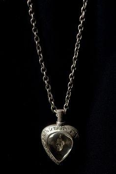 Skull perfume bottle pendant