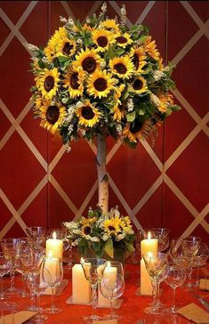 Sunflower Centerpieces For sunflower wedding. I wouldnt have this for centerpieces on all tables bit maybe just on the gift table or dinner buffet? Sunflower Wedding Centerpieces, Wedding Table Centerpieces, Wedding Flowers, Centerpiece Ideas, Topiary Centerpieces, Tall Centerpiece, Wedding Colours, Wedding Bouquets, Summer Table Decorations