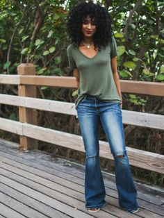 ecstasymodels:One Eleven Wearing: One Eleven Hi-Lo Hem Tunic Tee – Olive ℅ Express | Mid Rise Bell Flare Jean ℅ Express | Armor Ring Set ℅ L. Young Ria Michelle