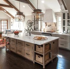 #1 choice. Natural wood island with greige or white cabinets.