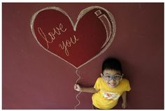 Valentine's Day Gift Idea: Frame a Great Photo! Get inspired by Cheng Bee's photo that won 1st place in the February 2011 I Heart Faces Photo Challenge.
