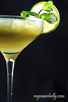 Coconut Mojito  Ingredients:    1 1/4 Ounce Spiced Rum  1 Teaspoon Turbinado Sugar (aka raw sugar)  1/4 Teaspoon Matcha Powder (actually just a little less than 1/4 teaspoon is perfect)  1/3 Ounce Lime Juice  8 Good Sized Mint Leaves (6 torn and 2 chiffonade)  Coconut Water    Di
