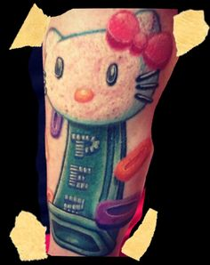 Hello kitty, pez dispenser tattoo by Veronica Dey www.missvtattoos.com