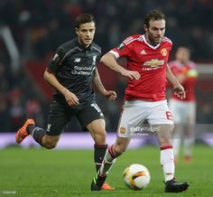 Juan Mata of Manchester United in action with Philippe Coutinho of Liverpool during the UEFA Europa League Round of 16 Second Leg match between Manchester United and Liverpool at Old Trafford on March 17, 2016 in Manchester, United Kingdom.