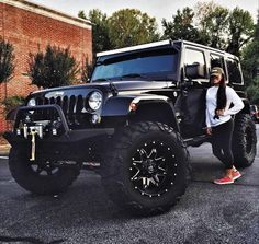 Girl standing next to Large black jeep woth large wheels. Girl standing next to - -Large black jeep woth large wheels. Girl standing next to - - Auto Jeep, Maserati, Bugatti, Jeep Carros, Dream Cars, Bmw Autos, Girly Car, Jeep Truck, Luxury Sports Cars