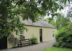 Clonleason Gate Lodge | Ireland Co. Meath Leinster. Books, paintings and roses at this enchanting cottage for romantics, hidden at the end of the drive. Linen and logs included...