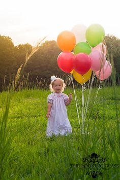 Happy Birthday photography ideas for a kid (: Maybe have the kid hiding in the balloons though?