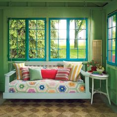 this happens to be a shed redo picture- but the cute colors + off-floor seating work for a small porch also.