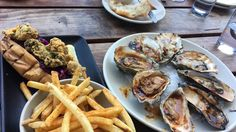 [I ate] grilled chipotle bourbon oysters fried oyster roll and seasoned fries.