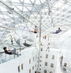 "Artist and architect ""Tomas Saraceno"" created a massive layered installation that's suspended more than 25 meters in the air of the Kunstsammlung Nordrhein-Westfalen museum in Dusseldorf, Germany."