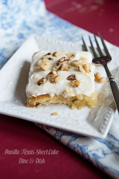Vanilla Texas Sheet Cake ~ a twist on a classic church potluck recipe, topped with a creamy vanilla frosting and chopped walnuts. Click through for recipe from www.dineanddish.net